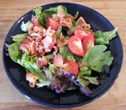 Hot Bacon Dressing over mixed Greens